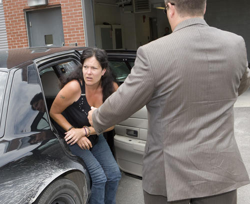 Cindy Lavigne, 46, of North Bay gets out of an OPP cruiser at Cobourg Court ...